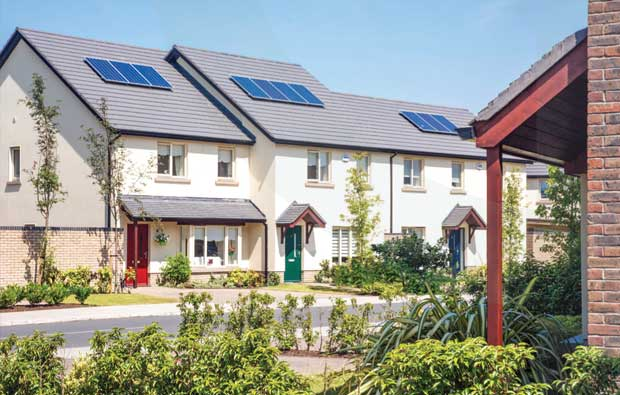 Street view of houses in Barnwell Woods. Bright sunny day. Solar panels can been seen on roofs